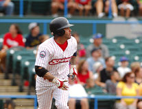 Garret Guzman heads to first base. CAMDEN, NJ - AUGUST 15: Camden Riversharks designated hitter Garret Guzman follows the flight of a ball he has just hit in a Stock Photography