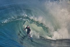 Garrett McNamara riding a wave in Nazare royalty free stock photo
