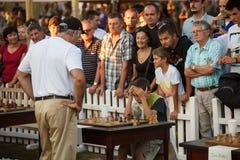 Garry Kasparov играя одновременную выставку Стоковые Изображения