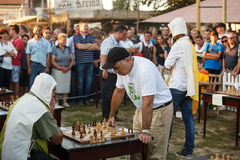 Garry Kasparov som spelar samtidig utställning royaltyfri foto