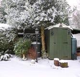 Garten im Schnee Stockfotos