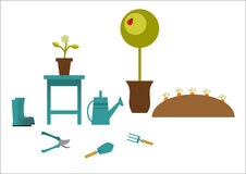 Gartenarbeitwerkzeuge auf einem grauen Hintergrund lizenzfreies stockfoto