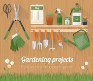 Gartenarbeitwerkzeuge auf einer hölzernen Wand lizenzfreie abbildung