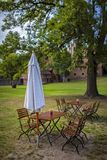 Tables and chairs with umbrella in a garden bar in brandenburg stock photos