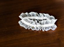 Garter. Beautiful wedding  bridal garter. Wedding day moments Royalty Free Stock Images