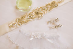 Garter of the bride with crystals. Wedding decorations of the br Royalty Free Stock Image