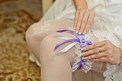 Garter of the bride. Royalty Free Stock Photos