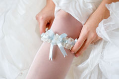 Garter on bride's leg Royalty Free Stock Images