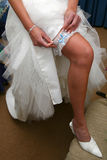 Garter Leg. Bride putting on her garter Stock Images