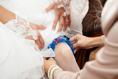 Garter on the leg of the bride.  Royalty Free Stock Image