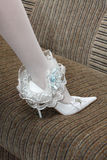 Garter on leg of the bride Stock Image