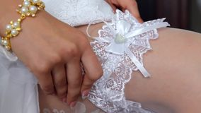 Garter on leg of bride stock footage