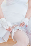 Garter on the leg of a bride Royalty Free Stock Image
