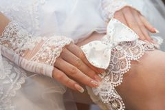Garter on the leg of a bride Royalty Free Stock Photography