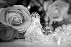 Garter and wedding rings Stock Images