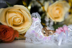 Garter and wedding rings Stock Image