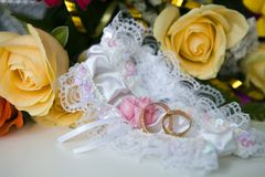Garter and wedding rings Stock Photo