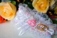 Garter and wedding rings Royalty Free Stock Images