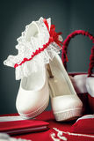 Garter on wedding shoes. Stock Image