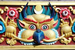 Garuda bird - sacred deity in hindu and buddhist mythology, arch. Itectural detail of monastery wall Royalty Free Stock Photography