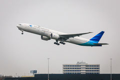 Garuda Boeing 777. Garuda Indonesia Boeing 777-300 taking off from Schiphol Amsterdam Airport Stock Image