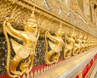 Garuda in Grand Royal Palace of Thailand to find. Gold Garuda Scupture in Ubosot of Wat Phra Kaew Grand Palace of Thailand Royalty Free Stock Photography