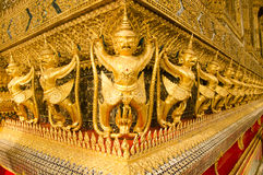 Garuda in Grand Royal Palace of Thailand to find. Gold Garuda Scupture in Ubosot of Wat Phra Kaew Grand Palace of Thailand Stock Images