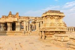 Garuda stone chariot and Vitthala temple gopuram, Hampi. Karnataka, India royalty free stock image