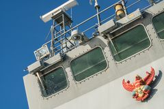 Garuda or Thai mythical bird emblem on the bridge of navy ship. Garuda or Thai mythical bird in East Asia novel emblem on the bridge of Thai navy ship Royalty Free Stock Image