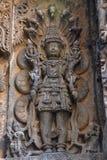 Garuda, Vishnu & Lakshmi. Hoysalesvara Temple, Halebid, Karnataka. Garuda, Vishnu & Lakshmi. Hoysalesvara Temple in Halebid, Karnataka. 12th Century. Shiva Royalty Free Stock Images