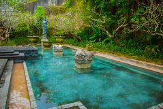 Garuda Wisnu Kencana Cultural Park, small pool with a sculpture. Bali. Indonesia. Beautiful small pool with a sculpture. Garuda Wisnu Kencana Cultural Park Royalty Free Stock Images