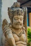 Garuda Wisnu Kencana Cultural Park, small statue of a Balinese spirit stone. Bali. Indonesia. Stock Image