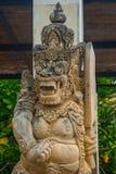 Garuda Wisnu Kencana Cultural Park, small statue of a Balinese spirit stone. Bali. Indonesia. Royalty Free Stock Image