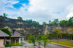 Garuda Wisnu Kencana Cultural Park. Wall of rock on which there is a relief image. Bali. Indonesia. Royalty Free Stock Photos
