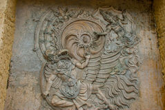 Garuda Wisnu Kencana Cultural Park. Wall of rock on which there is a relief image. Bali. Indonesia. Stock Images