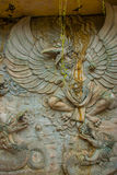 Garuda Wisnu Kencana Cultural Park. Wall of rock on which there is a relief image. Bali. Indonesia. Royalty Free Stock Photo
