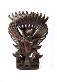 Garuda in wood. Handcrafted Garuda the mythical bird or bird-like creature that appears in both Hindu and Buddhist mythology. Also national symbol of Indonesia Royalty Free Stock Photos