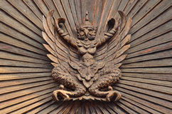 Garuda on the wooden wall Royalty Free Stock Image