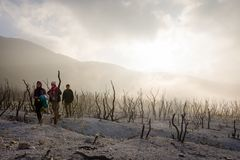 Free Garut, Indonesia - August 12, 2018 : A Group Of Young People Are Enjoying And Hiking Papandayan Mountain. Papandayan Mountain Is Stock Photo - 149702780