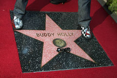 Gary Busey. LOS ANGELES - SEP 7:  Buddy Holly Star, with Gary Busey's feet and glasses at the Buddy Holly Walk of Fame Ceremony at the Hollywood Walk of Fame on Royalty Free Stock Image