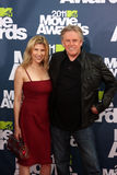 Gary Busey. LOS ANGELES - JUN 5:  Steffanie Sampson; Gary Busey arriving at the the 2011 MTV Movie Awards at Gibson Ampitheatre on June 5, 2011 in Los Angeles Royalty Free Stock Photo