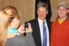 Gary Johnson Poses for Cell Phone Photo. Gary Johnson, former two term governor of New Mexico, announced that he will be seeking the 2012 Libertarian Party Stock Photography