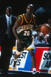 Gary Payton Seattle Super Sonics. Gary Payton guard for the Seattle Super Sonics driving the basketball up court. Gary Payton is an American retired professional royalty free stock image