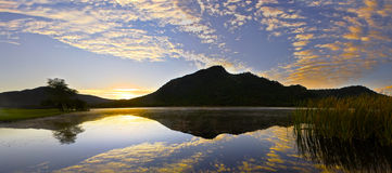 Gary Player Country Club Golf Course, Sun City. Sunrise over the lake, from the 17th green Royalty Free Stock Photo