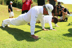 Gary Player with grandson, son of Mark Player,showing him how t Stock Photography