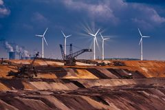 GARZWEILER, GERMANY - SEPTEMBER 01, 2016: Huge machines refill the opencast mine. With great earth structures royalty free stock image