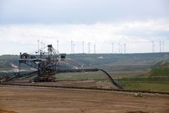 Garzweiler opencast mining lignite, Germany, controversial energy production against environmental protection. Heavy machine in Garzweiler opencast mining royalty free stock photos
