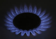 Gas_4. The flame of a gas-stove in the dark of a kitchen Royalty Free Stock Images