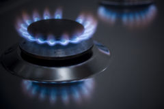Gas. Blue flames of gas stove Royalty Free Stock Photography