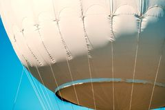 Gas balloon cables over the blue Stock Photography
